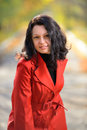 Beautiful woman in a red cloak Royalty Free Stock Photography