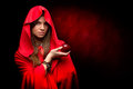 Beautiful woman with red cloak and apple holding Stock Photography