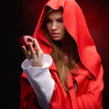 Beautiful woman with red cloak and fruit holding apple Royalty Free Stock Images