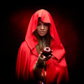 Beautiful woman with red cloak holding apple Royalty Free Stock Image
