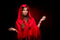 Beautiful woman with red cloak in studio Royalty Free Stock Photography