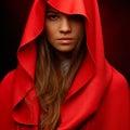 Beautiful woman with red cloak in studio Stock Image