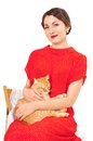 Beautiful woman in red dress with a cat Royalty Free Stock Photo