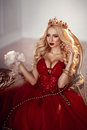 Beautiful woman in red dress and crown. Queen. Portrait. Royalty Free Stock Photo