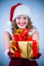 Beautiful woman in a red dress and hat of Santa Stock Images