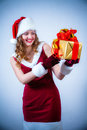 Beautiful woman in a red dress and hat of Santa Stock Image