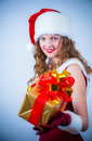 Beautiful woman in a red dress and hat of Santa Stock Photo