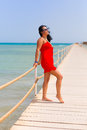 Beautiful woman in red dress on the pier of red se sea egypt Royalty Free Stock Image