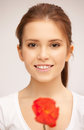 Beautiful woman with red flower picture of Royalty Free Stock Photos