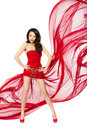 Beautiful woman in red flying dress. Hands on hips Royalty Free Stock Photo