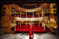 Beautiful woman in red gown on stage full length side view of a floor Stock Image