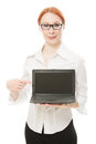 Beautiful woman with red hair with a laptop Royalty Free Stock Image