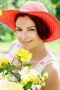 Beautiful woman in a red hat posing in the garden caucasian Royalty Free Stock Photos