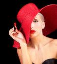 Beautiful woman in red hat with red lipstick hand Stock Images