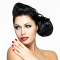 Beautiful woman with red nails and lips Stock Image
