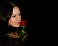 Beautiful woman with red rose on black background Stock Photography