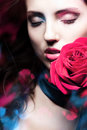 Beautiful woman with red rose and lights blue Royalty Free Stock Photos