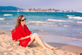 Beautiful woman with red scarf on the beach travel and vacation concept Stock Image