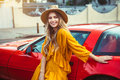 Beautiful woman with red sport car on summer vacation traveling concept Royalty Free Stock Photo