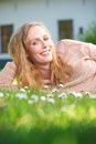 image photo : Beautiful woman relaxing on green grass and smiling