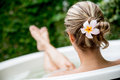 Beautiful woman relaxing at home and taking a bath Stock Images