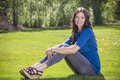 Beautiful woman relaxing outdoors on the grass Royalty Free Stock Photo