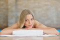 Beautiful woman relaxing in spa salon with hot stones on body. Beauty treatment therapy Royalty Free Stock Photo