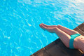 Beautiful woman relaxing in a swimming pool Royalty Free Stock Image