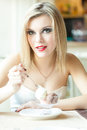Beautiful woman restaurant eating ice cream Royalty Free Stock Photo