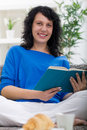 Beautiful woman resting at home reading a book young Royalty Free Stock Photo