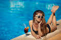 Beautiful woman resting near pool at maldives swimming on tropical resort Royalty Free Stock Photography
