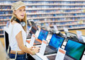 Beautiful woman in retail computer store Stock Photography