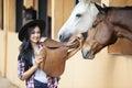 Beautiful woman rider at horse ranch Royalty Free Stock Photo