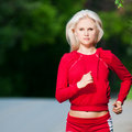 Beautiful woman running in park Royalty Free Stock Images