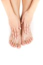 Beautiful woman's legs and hands on feet. Royalty Free Stock Photo