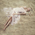 Beautiful woman on sand fashion art portrait of Royalty Free Stock Photo