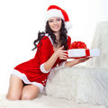 Beautiful woman in santa costume holding gift box Royalty Free Stock Image
