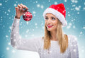 Beautiful woman with santa hat holding red Christmas Ornament Royalty Free Stock Photo