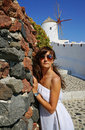 Beautiful woman on santorini oia town holidays wildmills Royalty Free Stock Image