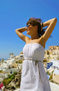 Beautiful woman on santorini thira town holidays view Stock Image