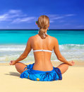 Beautiful woman in a sarong meditating Royalty Free Stock Images