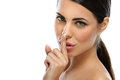 Beautiful woman saying shh sensual with finger on lips Royalty Free Stock Photo