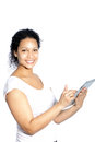 Beautiful woman scrolling on her tablet young african american using finger the touchscreen as she accesses the internet Stock Photo