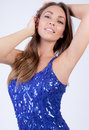 Beautiful woman in sequins a portrait of a stunning happy a blue sequin dress Stock Photo
