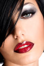 Beautiful woman with sexy red lips and eye makeup glamor closeup portrait of a female model Stock Images