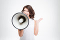 Beautiful woman shouting into megaphone Royalty Free Stock Photo