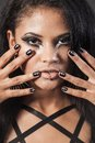Beautiful woman is showing nails fashion portrait close up fac face makeup black hair young studio shot Royalty Free Stock Images