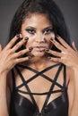 Beautiful woman is showing nails fashion portrait close up fac face makeup black hair young studio shot Stock Image