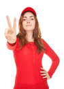 Beautiful woman showing victory sign or peace isolated on white in red Royalty Free Stock Photo