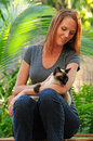 Beautiful woman with Siamese cat outdoors Royalty Free Stock Photo
